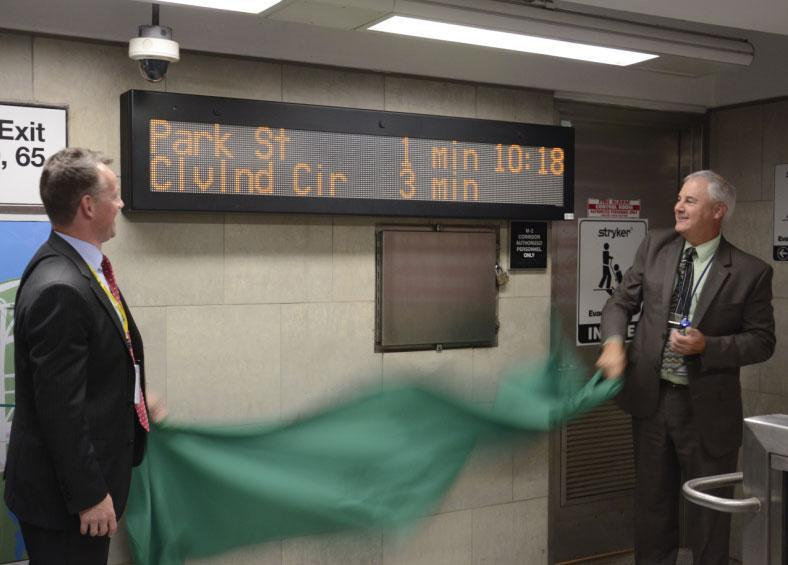 "MBTA Administrator Brian Shortsleeve (left) and General Manager Frank DePaola unveiled a new ""countdown"" sign at Kenmore Station in August."